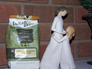 "A Willow Tree figure, ""Mother and Daughter,"" and bag of Paula Deen's flavored coffee--Hazelnut Rum Cake--Yum-O!"